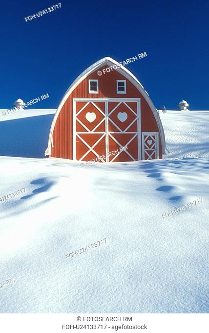 red barn, Vermont, VT, Snow-covered red barn with white trim at Diamond Heart Farm in East Albany in the winter