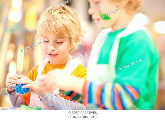 Boys using modelling clay