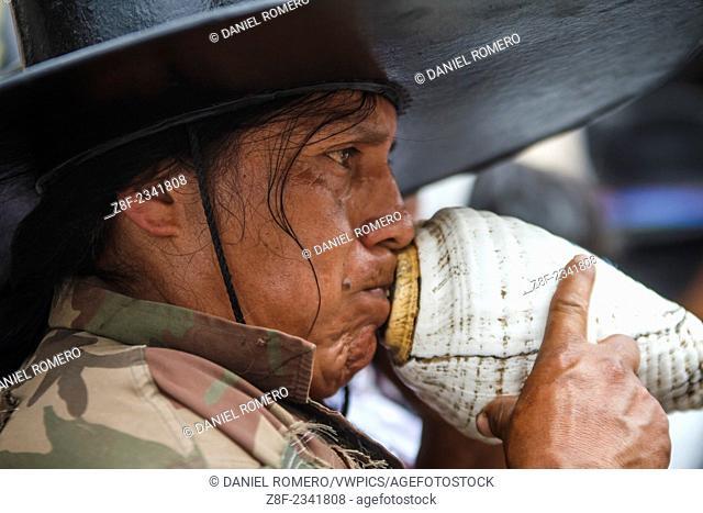 Taking the main square of Cotacachi by Indigenous communities, man playing churu