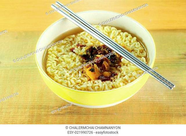 nstant noodles in yellow dish