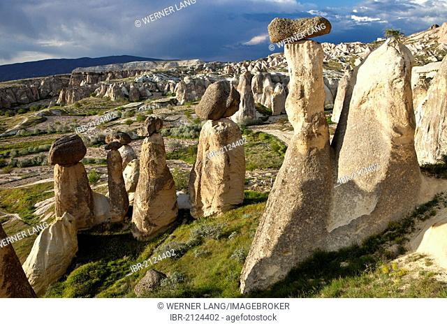 Tufa Fairy Chimneys with basalt blocks placed on top, rock formations at Cavushin, Goreme, UNESCO World Heritage Site, Cappadocia, Anatolia, Turkey