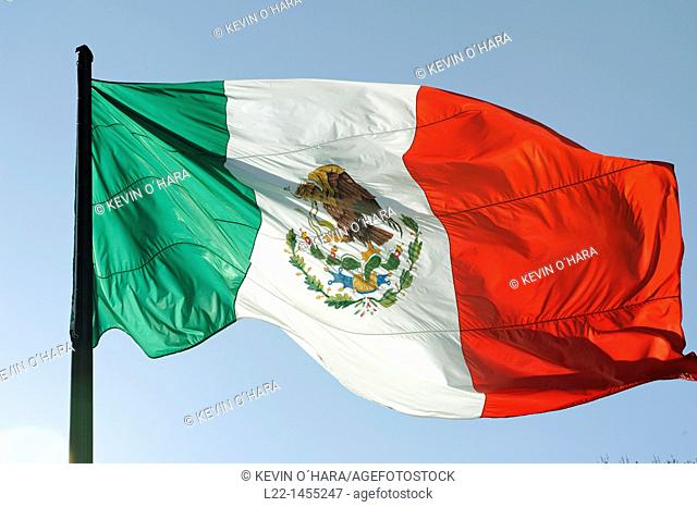 The flag of Mexico is a vertical tricolor of green, white, and red with the national coat of arms charged in the center of the white stripe