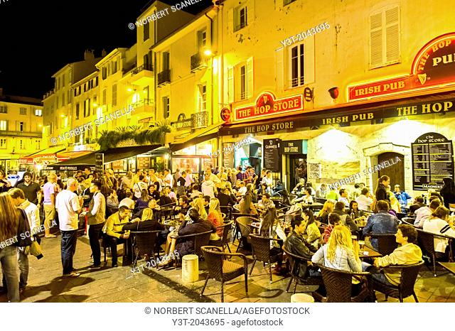 Europe, France, Alpes-Maritimes, Antibes. Old town at night. Young people out Saturday