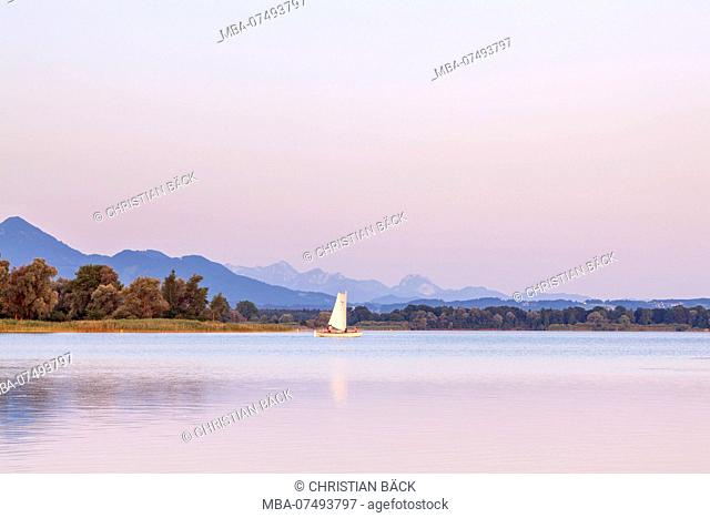 Sailboat on the Chiemsee in front of Chiemgau Alps, Übersee, Chiemgau, Upper Bavaria, Bavaria, Southern Germany, Germany, Europe