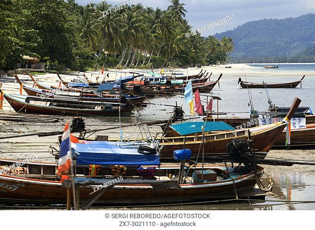 Fishers boats in the beach in Koh Mook island of Ko Muk or , Thailand, Southeast Asia, Asia. Sivalai Beach Resort. Koh Mook (Muk) is a small rocky island off...