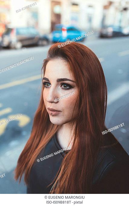 Portrait of red haired woman looking away
