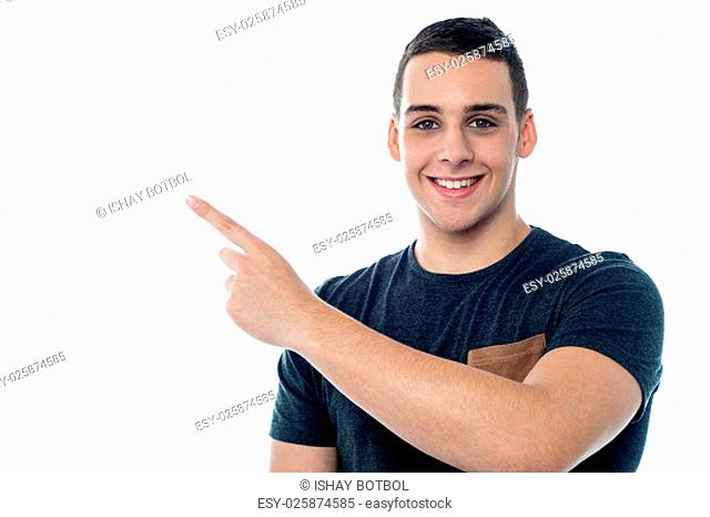 Young boy pointing towards something