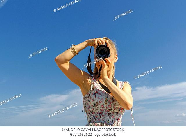 Woman taking pictures