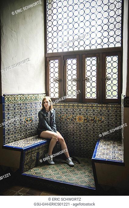 Young Woman Sitting Inside Santa Barbara County Courthouse, California, USA