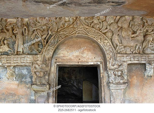 Orissa Udaigiri, Upper storey of Rani Gumpha showing chaitya arch resting over winged lions over the cell door, with forest scene on viewer's left and Queen...
