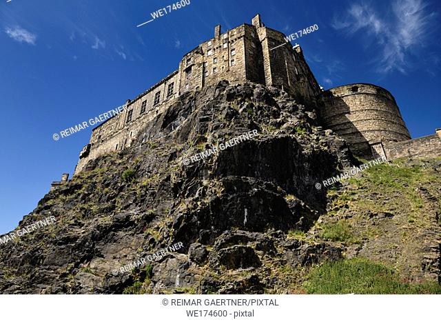 Volcanic plug cliff face of Castle Rock and Great Hall of the Royal Palace and half moon battery of Edinburgh Castle in Edinburgh Scotland
