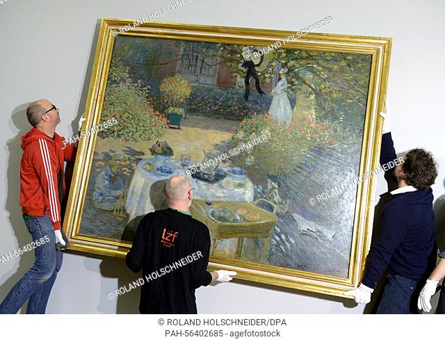 Employees of the Staedel Museum hang up the large-format painting 'The Lunch: decorative panel' (1873) by Claude Monet, in Frankfurt, Germany, 04 March 2015