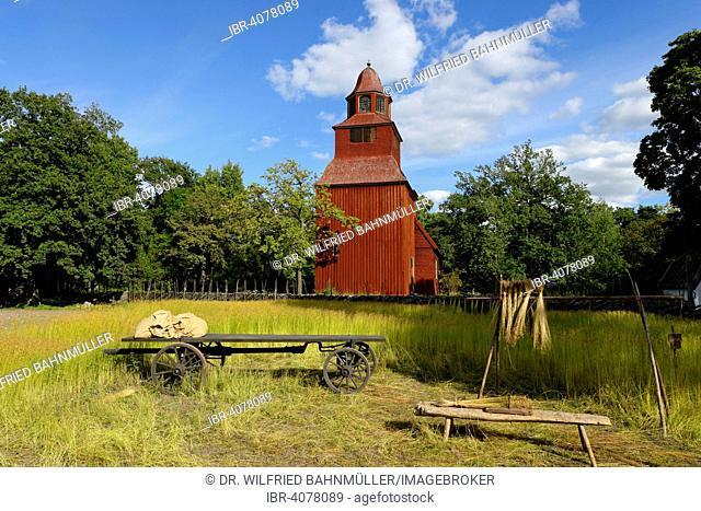 Wooden red Seglora Church or Seglora kyrka, 1729, Skansen open-air museum, Djugarden, Stockholm, Sweden