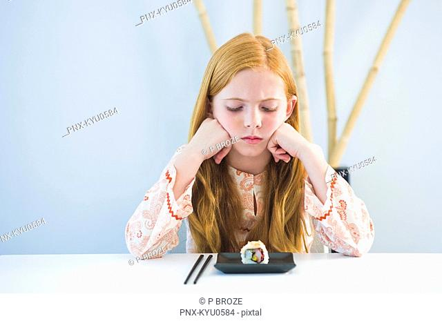 Girl at the dining table