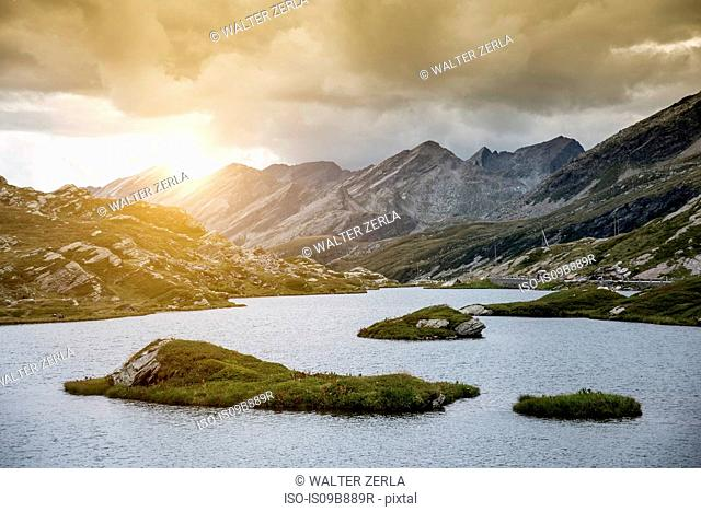Lake by mountains at sunset, San Bernardino, Ticino, Switzerland, Europe