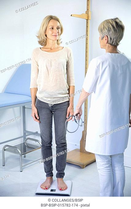 Woman being weighed at the doctor's