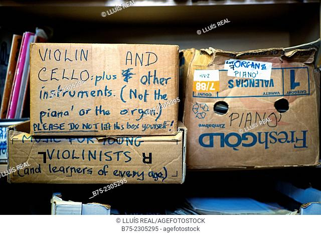 Shelves with boxes of sheet music with hand-written texts: Violin and cello plus other instruments, music for violinist, piano