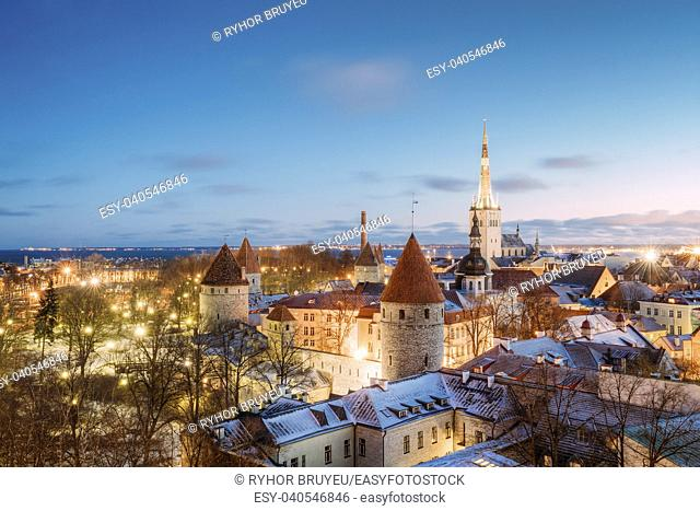 Tallinn, Estonia. Traditional Old Ancient Architecture Cityscape In Historic District Of Tallinn, Estonia. Winter Evening Night. Famous Landmark