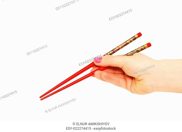 Hand with chopsticks isolated on the white
