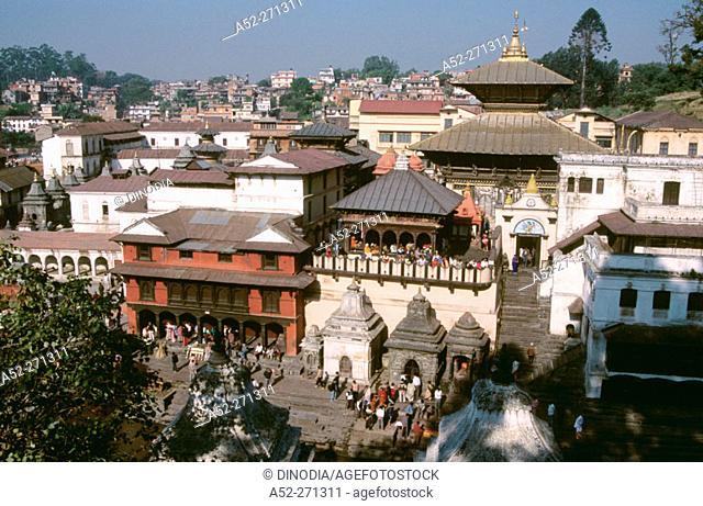 Cremation ghats on the banks of Bagmati River, Lord Shiva Pashupatinath Hindu Temple, Katmandu, Nepal