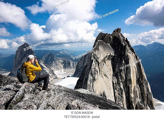 Man photographing mountain in Bugaboo Provincial Park, British Columbia, Canada