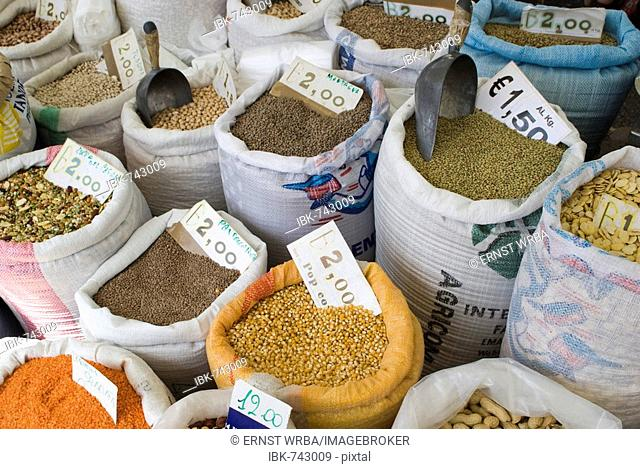 Stall selling legumes in sacks at the weekly market in Locorotondo, Apulia, Italy