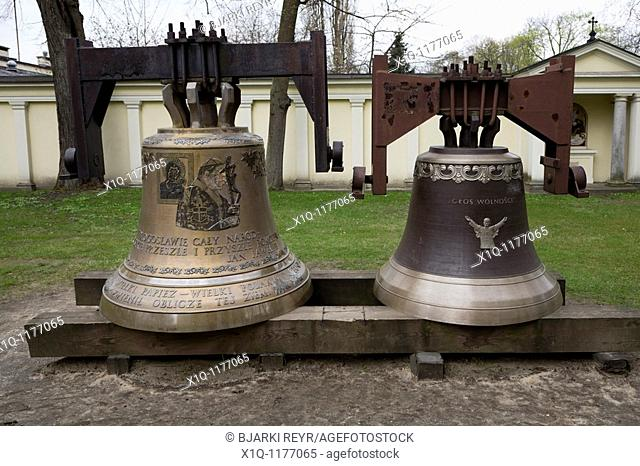 Large church bells in the garden of St  Ann's Church, Wilanow, Warsaw Poland