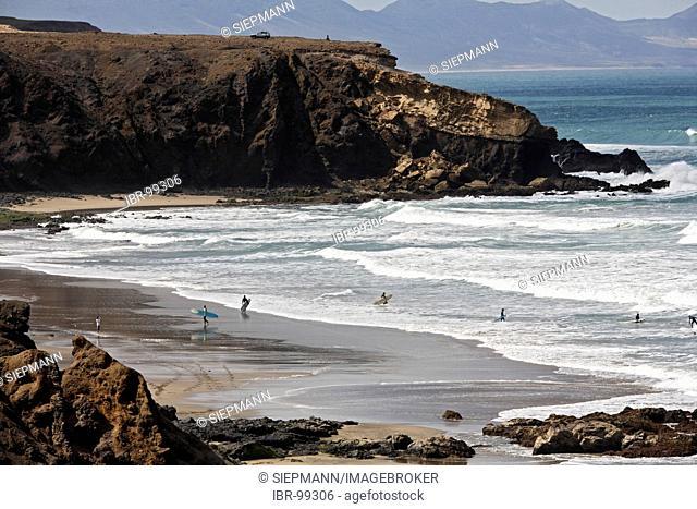Surfer at Playa del Viejo Rey in La Pared , Fuerteventura , Canary Islands