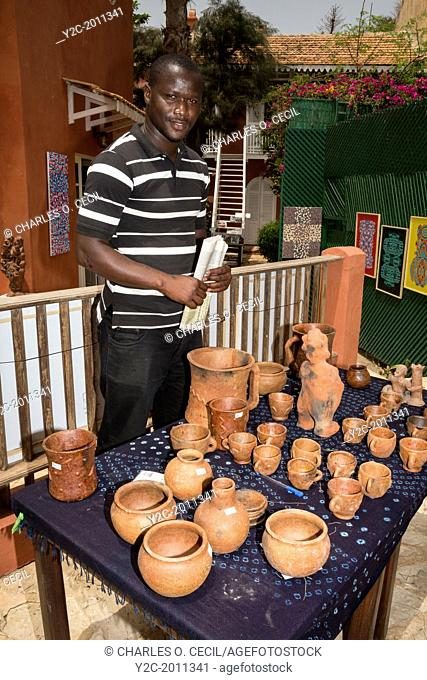 Dominique Diatta, from Casamance, Displaying his Mother's Pottery, Biannual Arts Festival, Goree Island, Senegal
