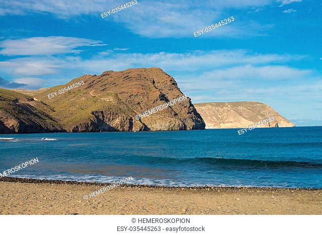 Las Negras beach with its dark volcanic rocks, Cabo de Gata, Andalusia, Spain