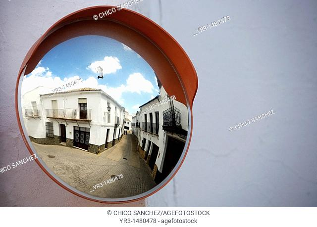 A traffic road mirror reflects a street of El Gastor, Cadiz province, Andalusia, Spain, april 25, 2011