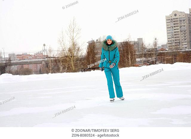 Young girl skating on the frozen lake, figure skating