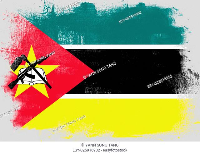Flag of Mozambique painted with brush on solid background