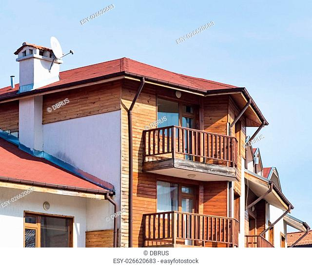 part of the house with a balcony roof gable
