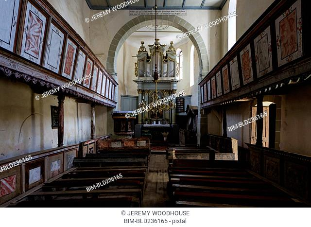 Pews in simple church, Viscri, Transylvania, Romania