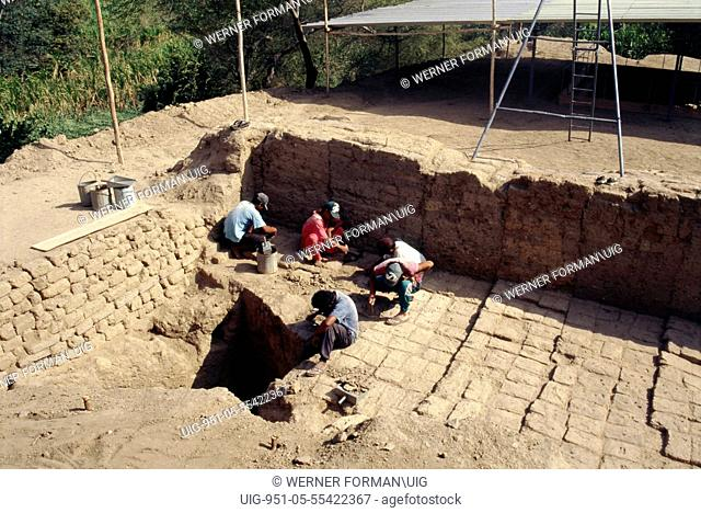Archaeologists at work on the excavation of the temple-tomb pyramid at Sipan, Lambayeque Valley