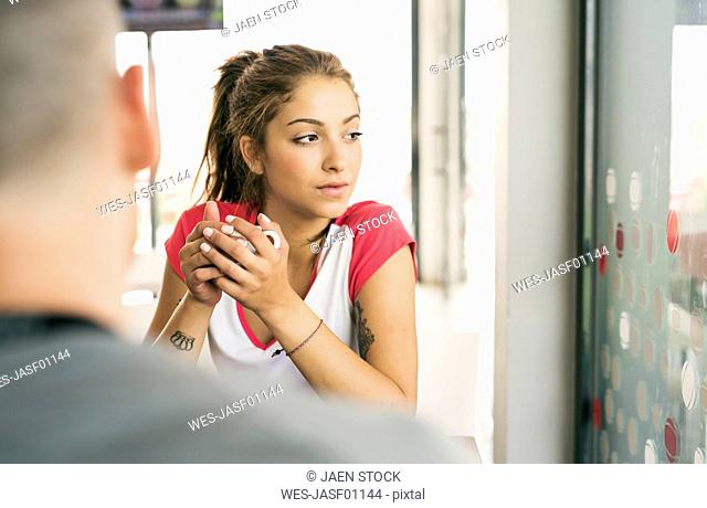 Young woman in a cafe looking away