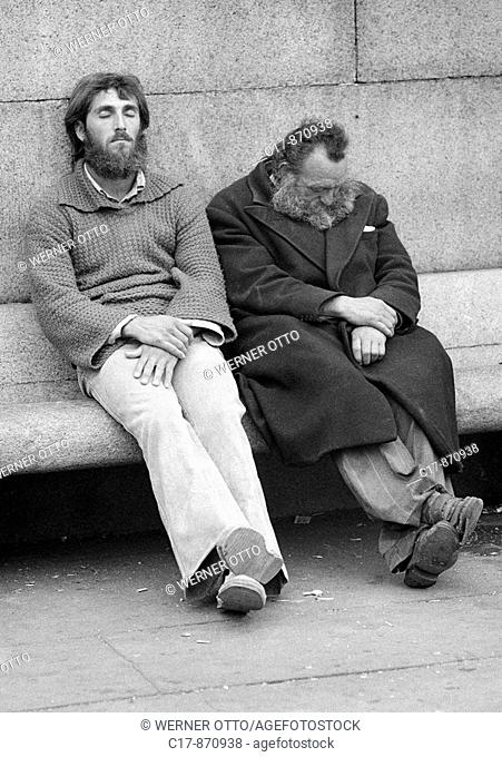 Seventies, black and white photo, people, two homeless men side by side on a bench, sleeping, depressed, aged 25 to 35 years, aged 50 to 60 years, Great Britain