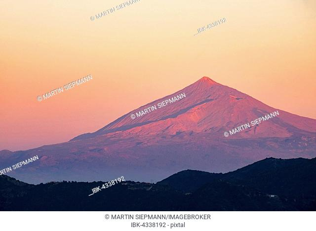 Mount Teide volcano on Tenerife at sunset, as seen from Vallehermoso, La Gomera, Canary Islands, Spain