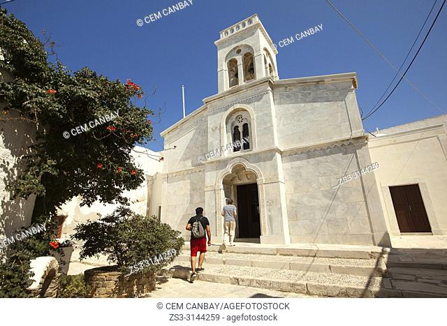 Tourists entering the Catholic church in the town center Chora, Naxos Island, Cyclades Islands, Greek Islands, Greece, Europe
