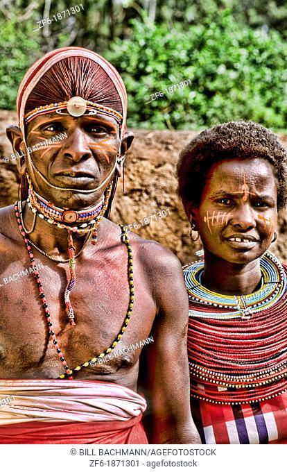 Maasai tribe people couple in costume traditional dress in jungles near hut near Kenya Africa