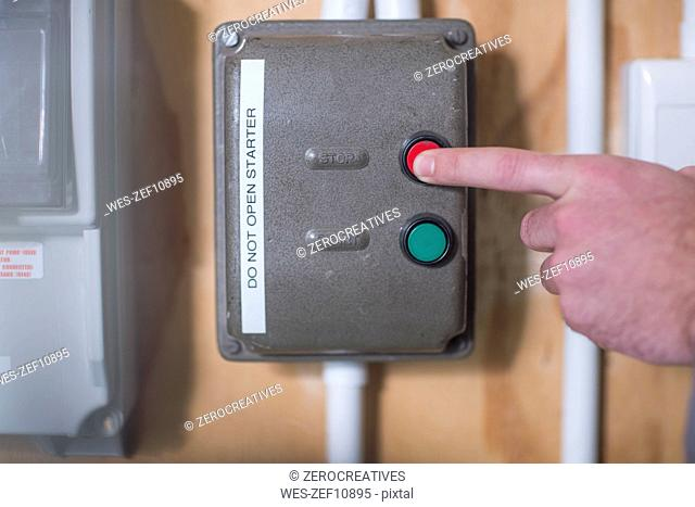 Hand turning off electrical control box
