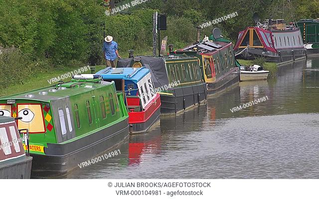 Anonymous man walking along the towpath on the Oxford Canal