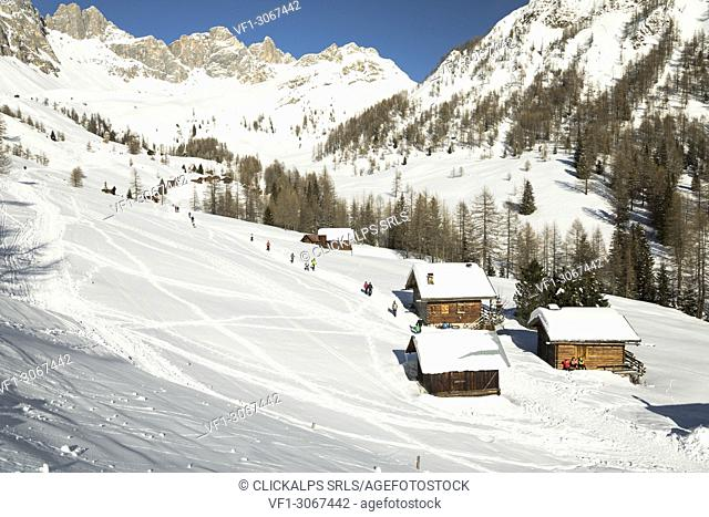 the typical mountain huts in Valfredda, a dolomitic valley near the San Pellegrino Pass, Belluno province, Veneto, Italy