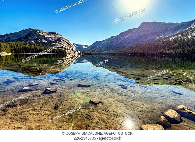 Polly Dome and Tenaya Peak at Tenaya Lake. Yosemite National Park, California, United States
