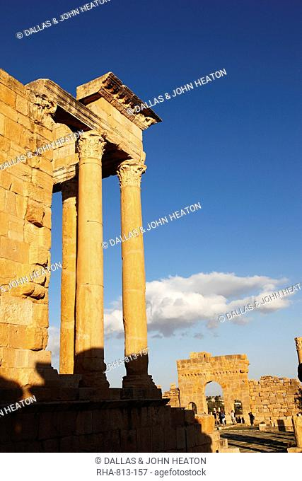 Columns of the Capitol and Arch of Antoninus Pius in the Forum at the Roman ruins of Sbeitla, Tunisia, North Africa, Africa