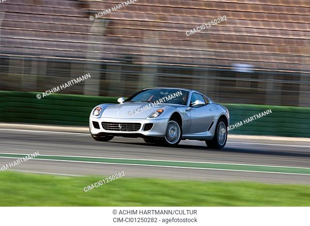 Ferrari 599 GTB Fiorano F1, model year 2006-, silver, driving, diagonal from the front, frontal view, test track