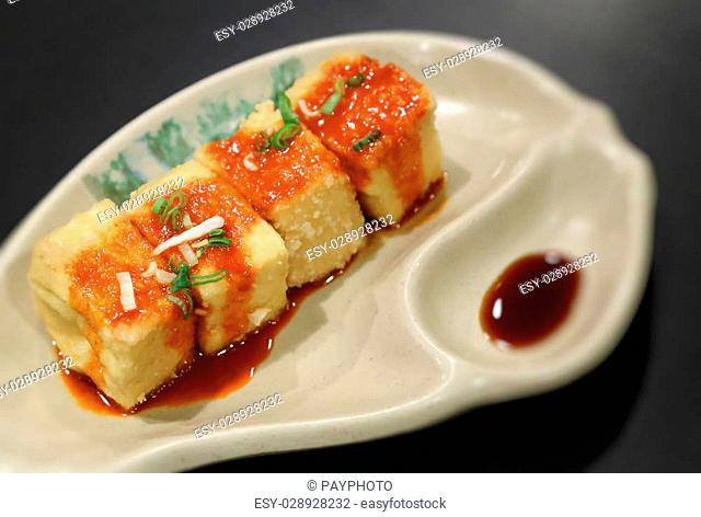 Tofu and sauce at restaurant