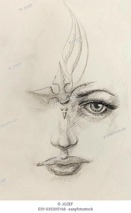 mystic woman face. pencil drawing on paper