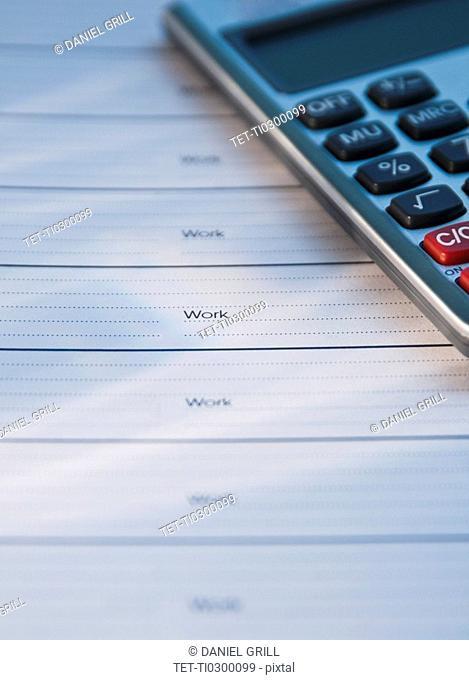 Close up of datebook and calculator